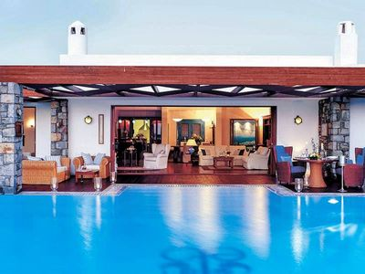 Photo for This 2-bedroom villa for up to 4 guests is located in Elounda and has a private swimming pool, air-c