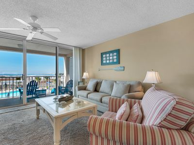 Photo for Gorgeous bay view condo, beach setup and bicycles included, Close to shopping