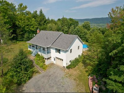 Photo for Spacious and beautiful cottage with pool in Eastern Townships