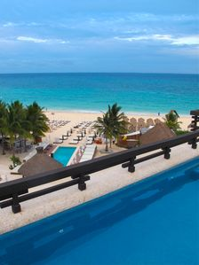 Overlooking the beach from your private rooftop pool!