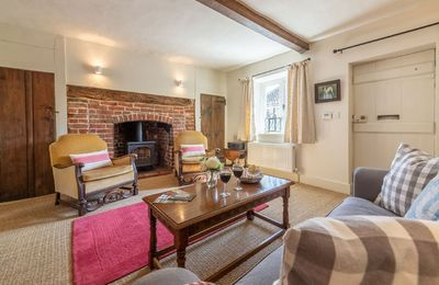 Ground floor: Sitting room with gas-fired wood burner effect stove