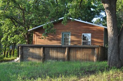 Catfish Cabin sits on 1/2 acre wooded lot less than 2 blocks from Lake Texoma