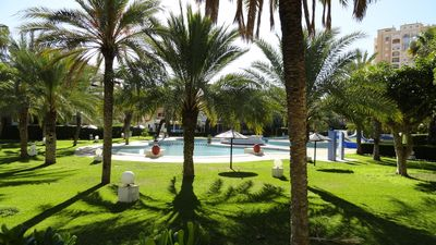 Photo for Residential apartment with gardens pool a few meters from the sea