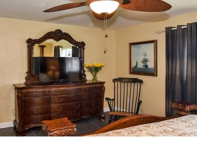 Master bedroom with rocking chair and TV, two closets