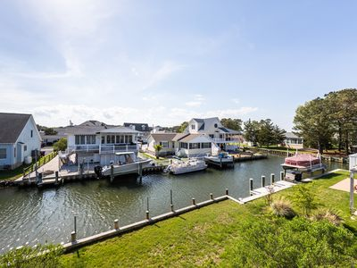 Photo for Canal front cottage in quiet neighborhood with furnished deck and free WiFi!