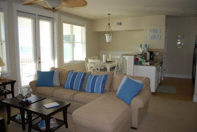 Living room offers a queen sleeper couch.  The room overlooks the bay and pool.