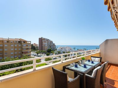 Photo for Fantastic apartment near the beach w/ free WiFi, central AC, & terrace!
