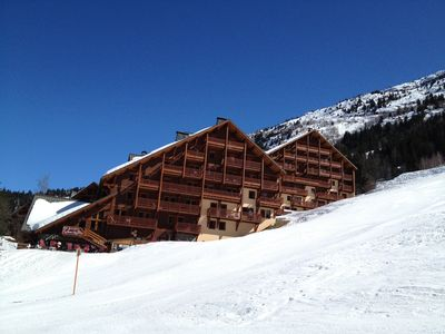 Photo for Charming Ski-In-Ski-Out Chalet (sleeps 10 in 5 bedrooms)