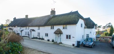 Photo for Delightful thatched cottage in beautiful sleepy Dorset village and countryside