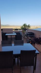 Two patio tables (seat 8 & 4) plus BBQ as seen on our 15 yard long side terrace