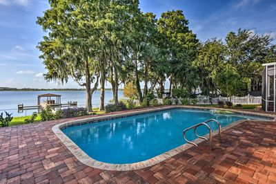This pool is framed by tropical trees and stunning lake views!