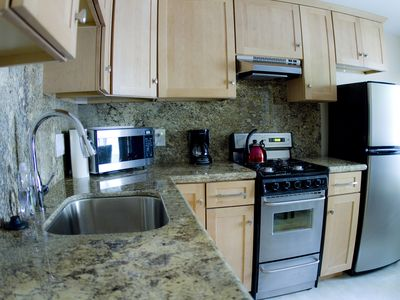 Stainless Steel Appliances with Custom Granite Countertops.  Ample Space!