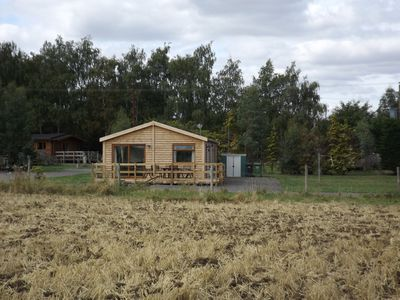 Photo for Spacious family friendly cabin sleeps 7, open rural view, set well back off road