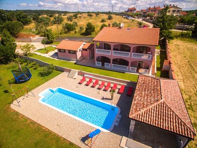 Photo for Beautiful villa set on the bechfront surrounded with olive trees and vineyards