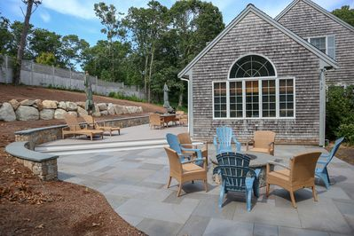 Brand new patio with a gas firepit, and deck