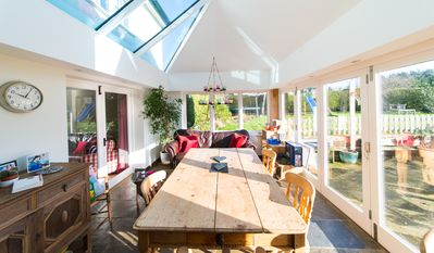 Large kitchen/diner with bifold doors onto sunny patio