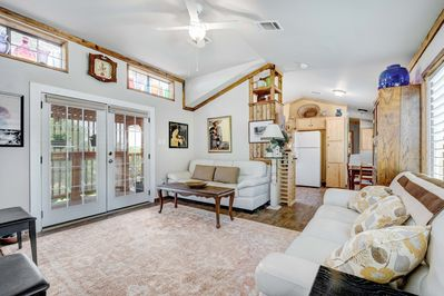French Doors open fr living room onto 2 decks, 1 protected w/sunshade, 1 open.