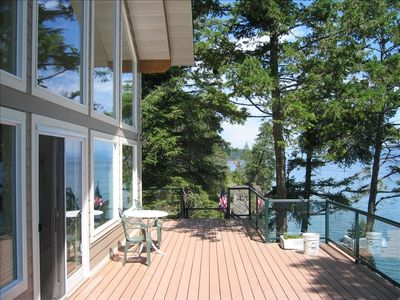 FRONT OF CABIN WITH DECK AND LAKE
