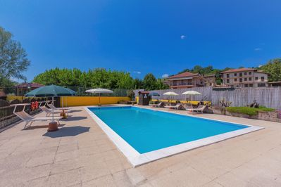 Communal outdoor swimming pool, garden and terrace