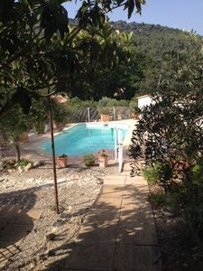 Photo for air-conditioned apartment at the foot of laces of Montmirail, swimming pool access