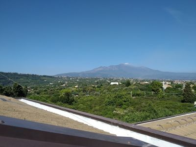 Photo for Loft overlooking the sea and Mount Etna, pool, wifi
