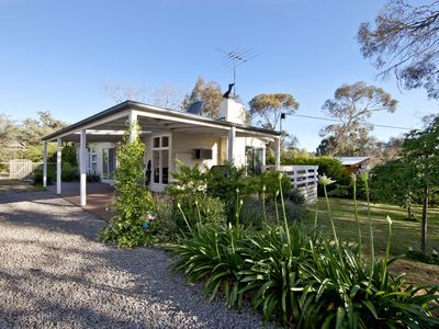 Photo for North Haven - Lovely coastal cottage, private fenced garden, cubby house, walk to beach and village.