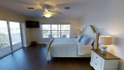 Spacious bedroom with great water views. Leads to screened porch