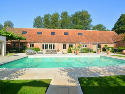 Photo for Stylish holiday home in peaceful, rural location, with heated outdoor pool and hot tub