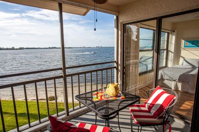 Your balcony with amazing views of the Bay, pool, birds, and boats.