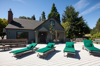 Huge deck with teak chaise lounges.