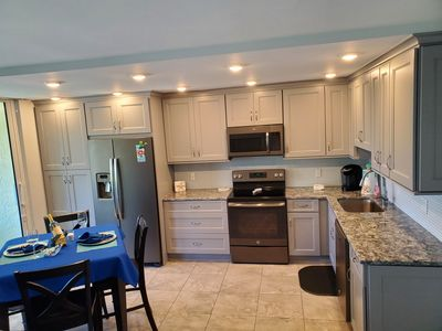 Bright fully renovated kitchen for the cook in your party.