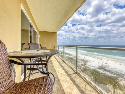 Photo for Beachfront condo w/ tropical touches, a private balcony, gym, & shared pool
