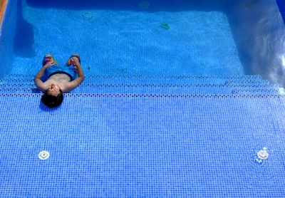 This is what summer in Spain means,relaxing in the pool,not a care in the world