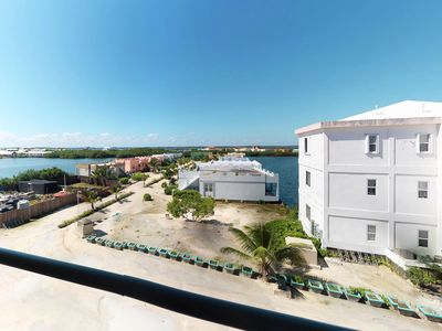 Photo for Comfortable, waterfront condo with shared pool - walk to the nearby beach