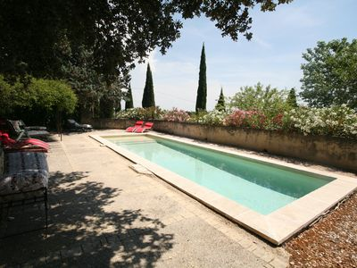 Photo for Provencal farmhouse from the 18th century, between wines & woods, fenced pool