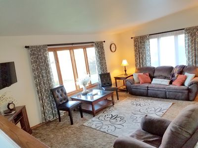Upstairs living room with satellite tv, rocker recliner, reclining sofa