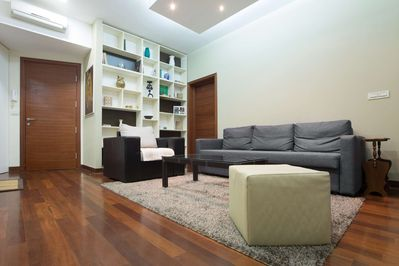 Living room with double sofa bed and armchair