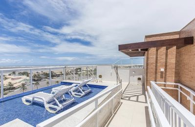 Photo for Brand new apartment on the seafront of Atalaia beach.