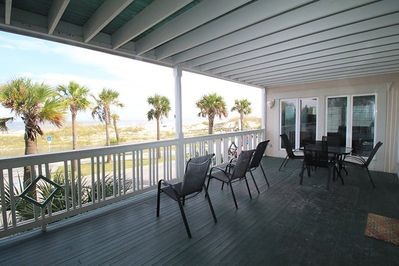 Large, private balcony with plenty of seating for all to take in the ocean sound