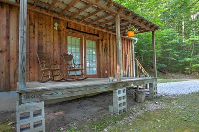 The rustic cabin is secluded in the beautiful forest.