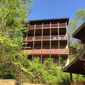 Photo for 5 bedroom cabin w/ all king beds, hot tub, game rooms, and much more!