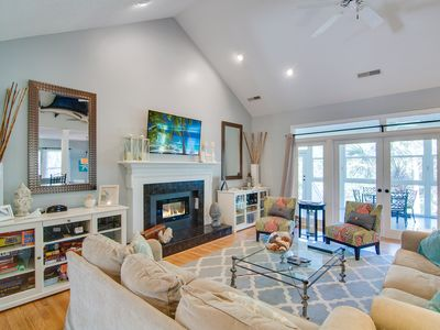 Photo for Gorgeous seaside home w/ large yard, sunroom & deck – steps to beach access!