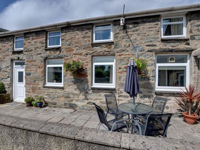 Photo for Near Porthmadog adjoining the owners' farmhouse is Lle Bach, a cottage with its own patio and lovely