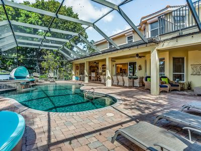 Photo for NEW LISTING! Beautiful, waterfront home w/ private lanai, pool, & dock