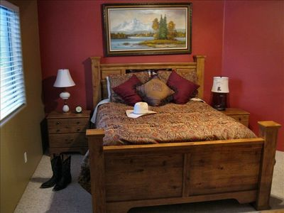 Master with queen bed, rocking chair, TV, walk in closet and private bath.