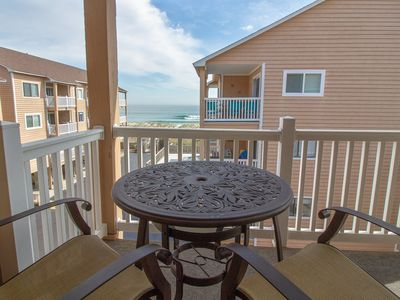 Photo for Comfy condo with pool and beach access! Enjoy ocean views from your private deck.
