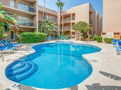 Photo for Beach-adjacent condo with shared pool offers easy access to shops, restaurants!