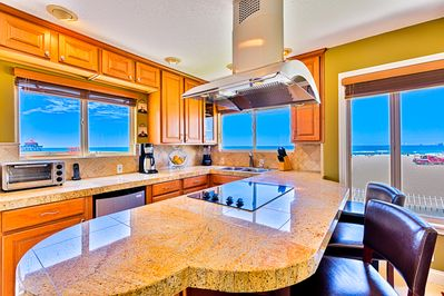 Kitchen with ocean view.  Blender, toaster, toaster oven, coffee maker & dishes
