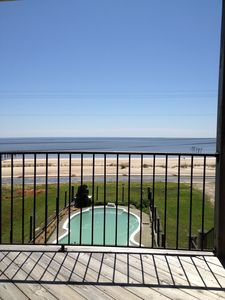 view from the gated porch overlooking the pool and  beautiful gulf beaches