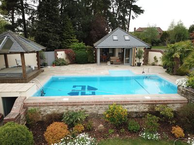 Photo for Stunning 6 Bedroom house with heated pool on Surrey,Hampshire, Sussex borders.